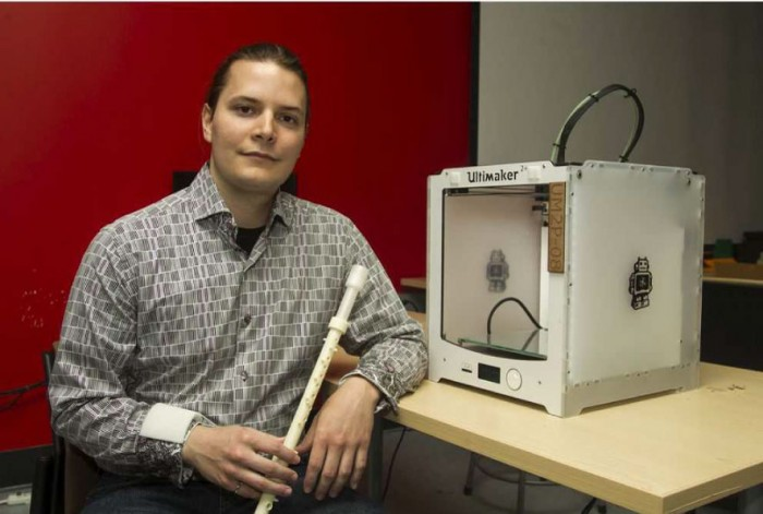 Robert Hunter, engineering PhD student with his winning 3D printed clarinet
