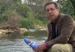 Professor Eugene Cloete with tea bag water filter.