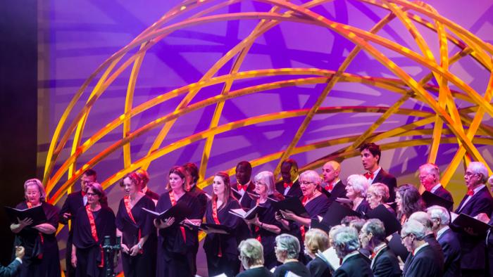 Choir singing under Arch structure