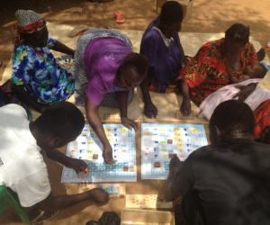 As Africa's poorest go from aid to trade, Design without Borders and the UN's World Food programme are helping a group of Ugandans to become truly self-reliant with the Aki Financial Literacy kit.
