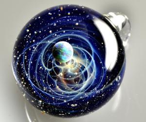 Satoshi Tamizu's work places tiny worlds into pendants.