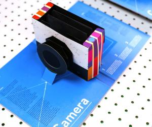 Designer Kelli Anderson has perfected a sequence of cuts and folds that turn a piece of paper into a functional camera that pops up from the centre fold.