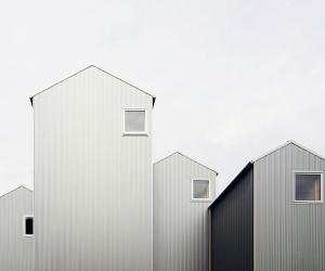 Standing at different heights, these steel-clad towers form one playful residence in Japan's city of Kosai.