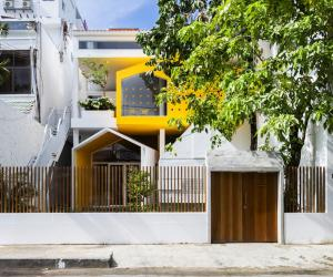 Kientru O Architects converted this building from an old townhouse into a vibrant ochre-and-yellow themed nursery school.