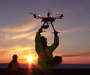 Operator letting go of a drone for testing