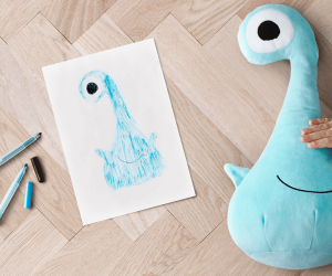 Blue monster with original drawing