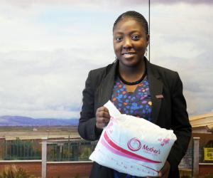 Adepeju Jaiyeoba holding a Mother's Delivery Kit