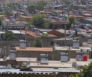 Solar panels in Alexandra, Johannesburg. KIM LUDBROOK/EPA