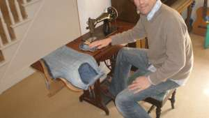 John-Paul Flintoff at his sewing machine.
