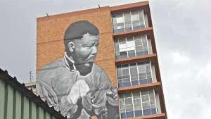 Freddy Sam's Madiba mural from the original photo by Bob Gosani © BAHA foundation.