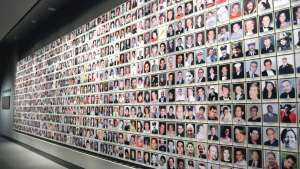Wall of photos as 9/11 Memorial Museum.