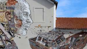 Vhils & Pixelpancho collab in Lisbon
