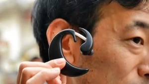 A PC worn in the user's ear.