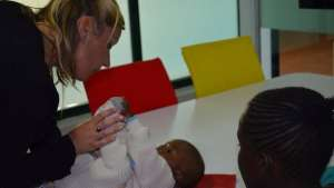The Totohealth workers help parents take care of their children.