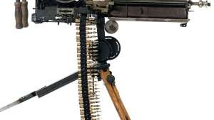 Artist's mock machine guns are sculpted from old typewriters