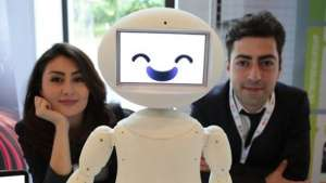 LuxAI's robot with Aida Nazariklorram, co-founder and Chief Medical Officer, and Dr. Pouyan Ziafati, founder and CEO