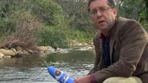 Professor Eugene Cloete with tea bag water filter.