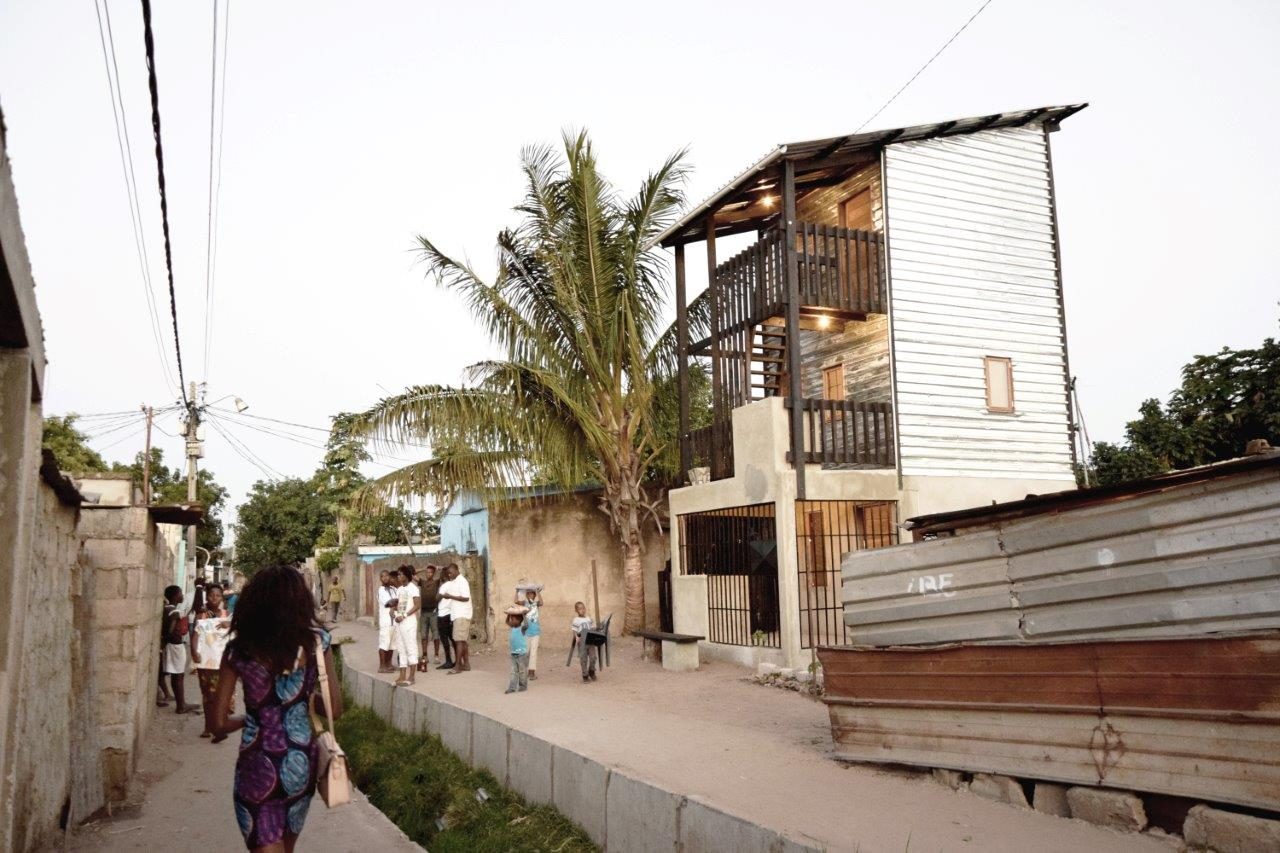 Low-cost house in Mozambique features corrugated iron and ...