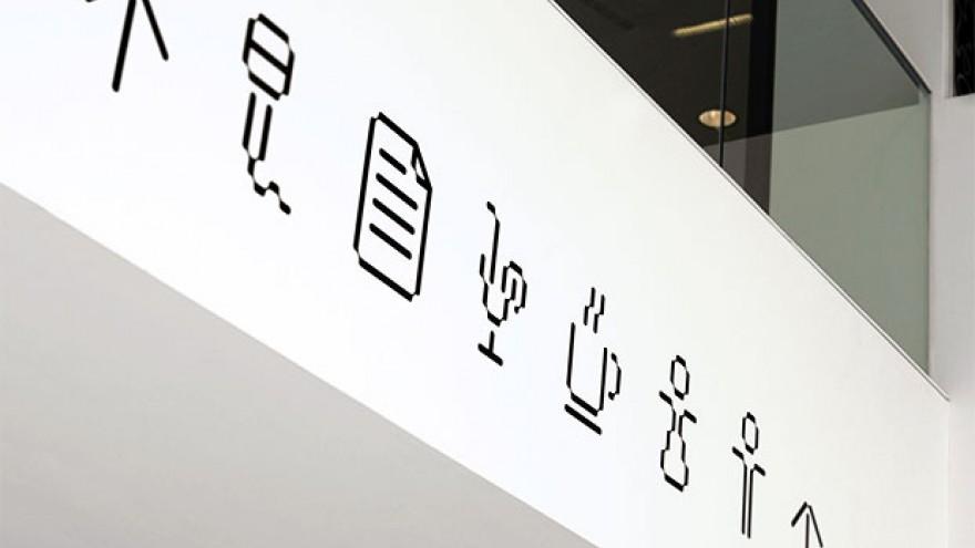 Platform identity, signage by Eddie Opara.