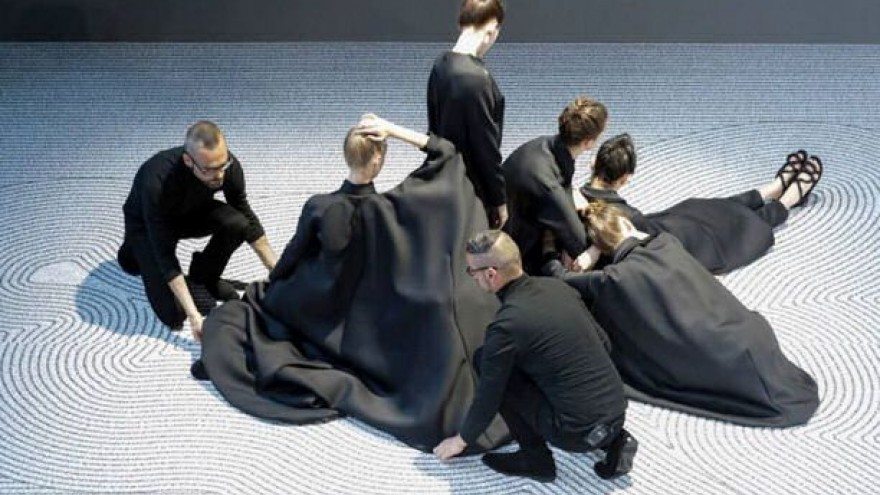 Viktor&Rolf's fashion show for its 2013 collection – rather than the collection itself – was chosen in the fashion category.  In the first couture show by the label in 13 years the models, wearing flat sandals and high-necked, often loose-fitting dresses with asymmetrical bulges, were arranged on the ramp to resemble a living Zen garden. Seated in portrait and landscape poses, they created a serene performance.