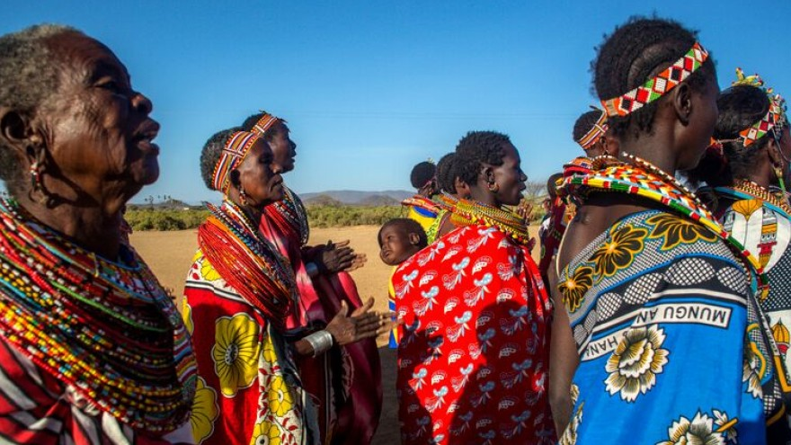 Women from Umoja sing to perform at the campsite for visitors. They hope performance and interaction will earn them some money.