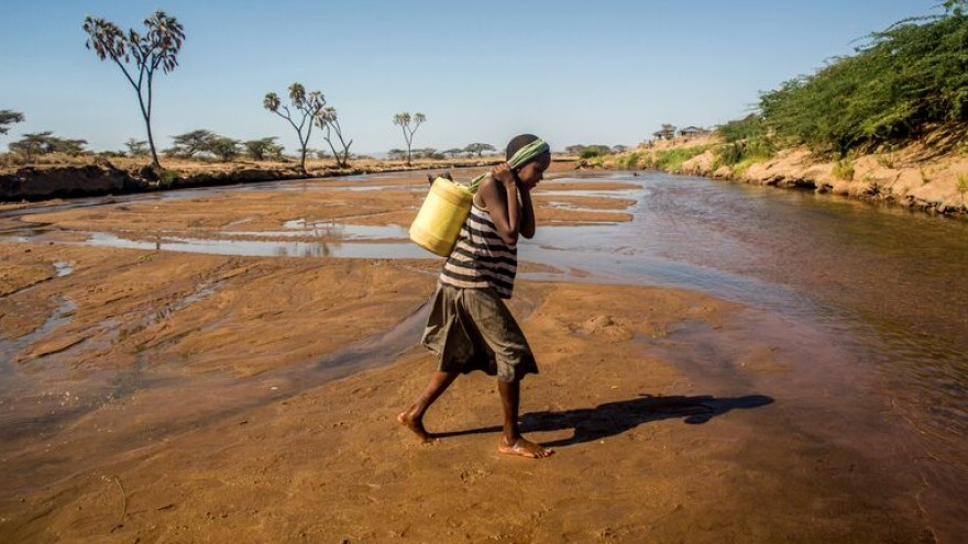 9-year-old Asunta collects water from the Uaso Nyiro River.