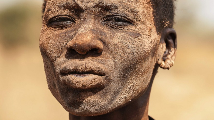 A Mundari woman with the ritual facial scarring, typical of their tribe, and covered in ash, a natural antiseptic which also protects the skin from insects and the sun. Image:© Tariq Zaidi / ZUMA Press