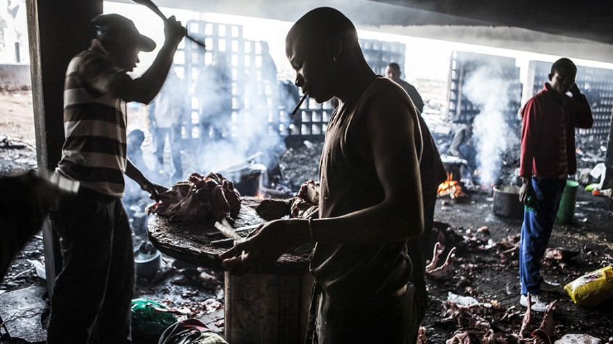 """Informal butchers. """"Wake up, This is Joburg"""" is a series of 10 books that tells the stories of the peculiar urban inhabitants of Johannesburg. Image: Mark Lewis"""
