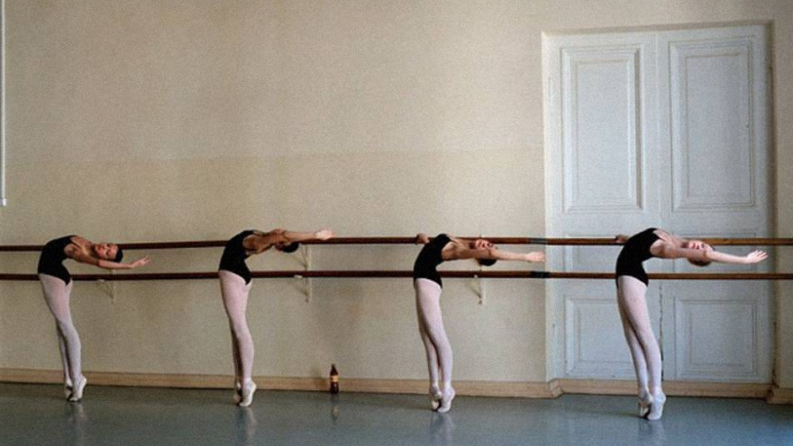 A group of dancers at the barre
