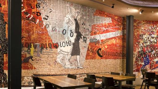 """""""Coming to the City"""" (2011), a site-specific mosaic artwork by Clive van den Berg in Nando's Kings Cross London restaurant."""