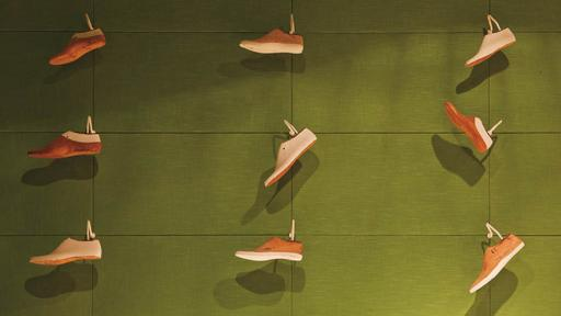 Tascón's two new shoe stores in Barcelona are contemporary in look, monochromatic in colour and use old shoe lasts to decorate the walls. Photo curtesy of Albert Font.