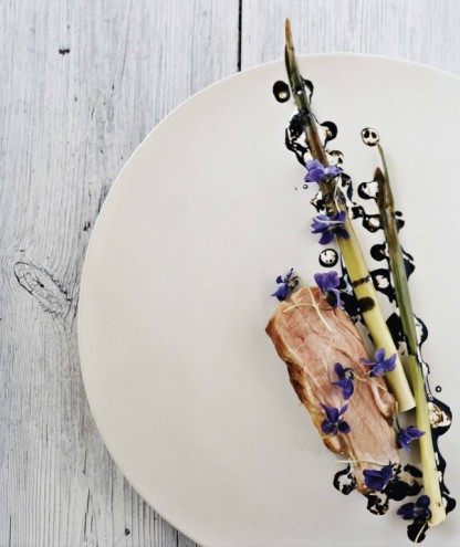 Pork neck with bulrushes, violets and malt. From Noma: Time and Place in Nordic Cuisine. Photo by Ditte Isager. Courtesy of Phaidon Press, www.phaidon.com