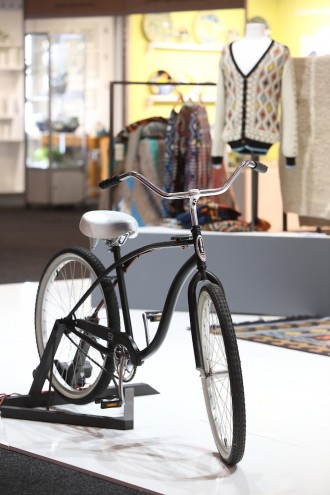 A bicycle on the Mohair SA stand powered a knitting machine that knitted scarfs that will be donated to charity.