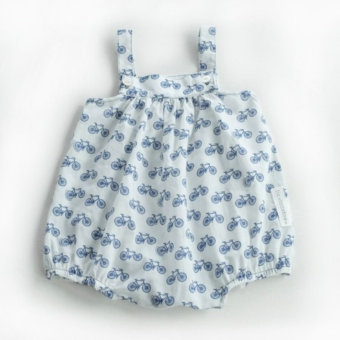 Navy bikes on white cotton baby dungaree from Tic Tac Toe.