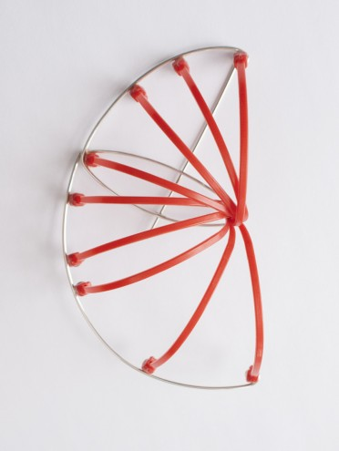 A brooch by Sarah Rhodes as part of the early exploratory process of working with cable ties.