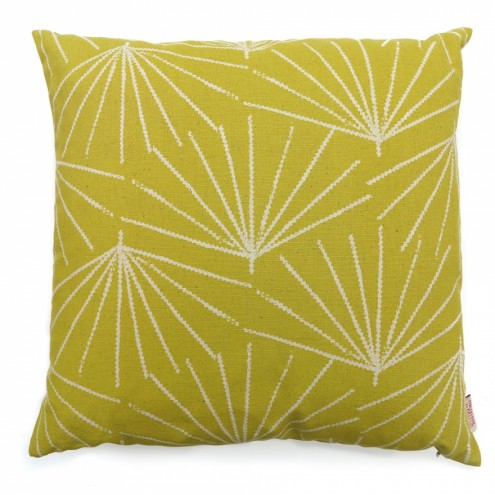 A cushion covered in Palmetto from Skinny laMinx's new Paradise is Here collection.