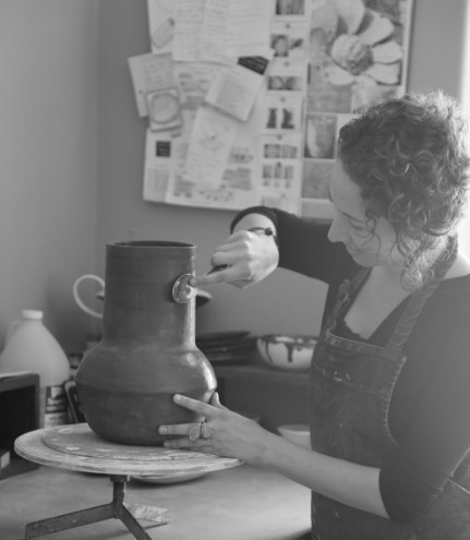 Working at her home studio, burnishing a vessel vase from the Africa-inspired The Berg Collection to give it shine. Image: Inness Mass.