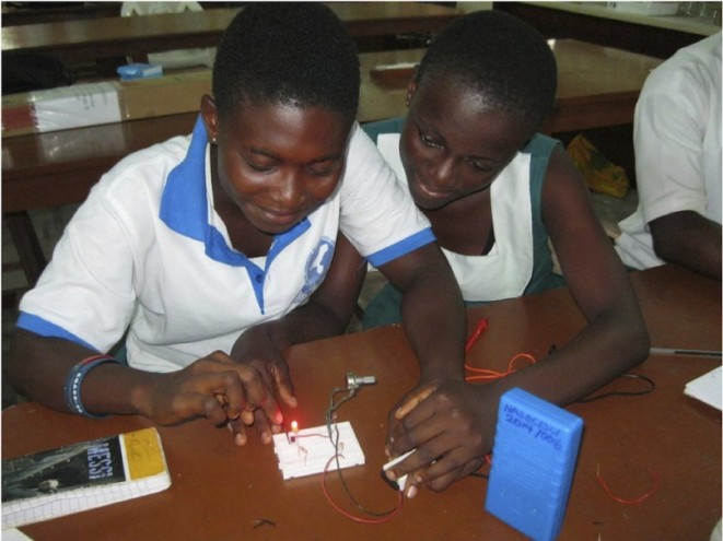 Female students from Ngleshie Amanfro Senior High School in Ghana participate in a light sciences workshop at Ada College of Education in Ghana.