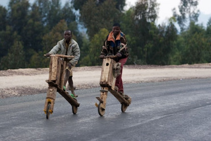 In eastern Congo, hand-hewn, low-tech scooters called chukudu's are a used to carry heaps of cargo, from food to fuel to bricks, across long distances. Image: Todd Lawson