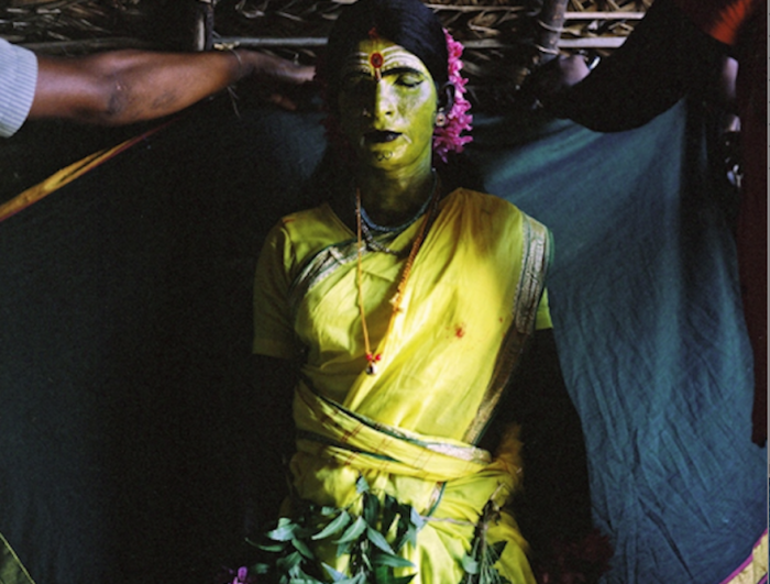 A Kothi prepares to play the goddess Amman in the Mayanakollai festival.