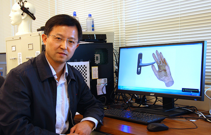 hand-worn robotic device to help the blind