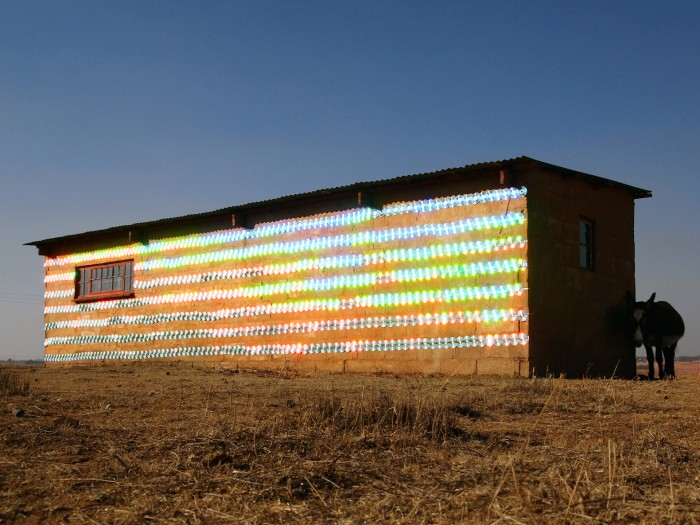 A rural South African farmhouse clad in 1000 shimmering CDs