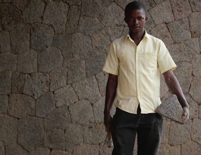 """""""What makes me happy is that people in this neighbourhood tell me I have done something beautiful here. I will build my house with this stone."""" Master Mason Hakiza Emmanuel worked on the volcanic stone facades of the Butaro Hospital, Rwanda"""