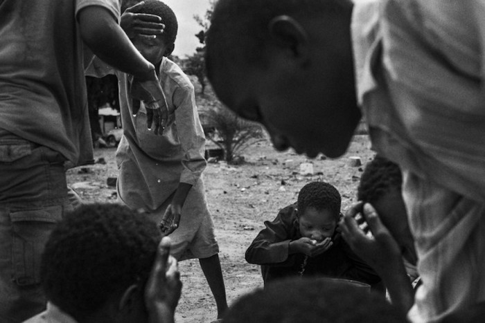 Children that used to be talibes cool off at SOS Talibe Center in Bafata, Guinea-Bissau, June 8, 2015. The Center received 45 cases of talibes returning from Senegal in 2014.