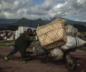 In eastern Congo, hand-hewn, low-tech scooters called chukudu's are a used to carry heaps of cargo, from food to fuel to bricks, across long distances. Image:mzaztiz.blogspot