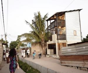 Casas Melhoradas, a double storey, low-cost house by Architects Without Borders, reinterprets Mozambique's traditional corrugated iron and wood homes.