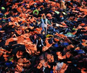 Volunteers on the Greek Island of Lesbos are taking the neon-orange lifejackets left by migrants and turning them into temporary mattresses