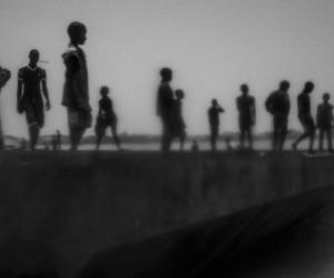 Runaway talibes stand on the bank of Senegal river, in Saint Louis city, north of Senegal, May 20, 2015.