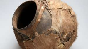 Water or beer African pot, covered with skin, from the Iziko Social History Collection.