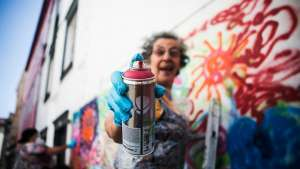Urban Art Workshops for Seniors is a programme that is putting spray cans in the hands of Lisbon's pensioners, who are now part of a group called Lata 65. Photo credit Rui Soares